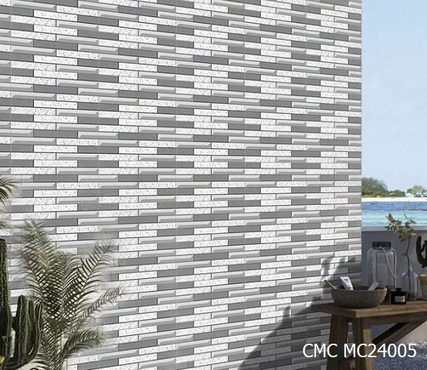 Gạch ốp tường ngoại thất CMC MC24005 giả đá tone màu xám - trắng đẹp tự nhiên, hiện đại. Bề mặt gạch phẳng chống bám bẩn.
