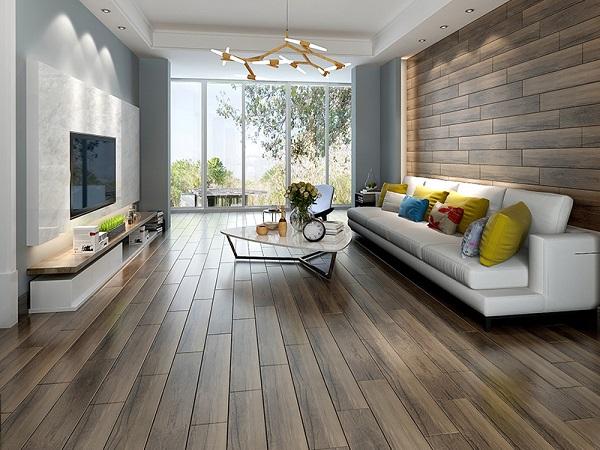 Sử dụng cùng 1 mẫu gạch ốp tường phòng khách vân gỗ tạo sự ấn tượng