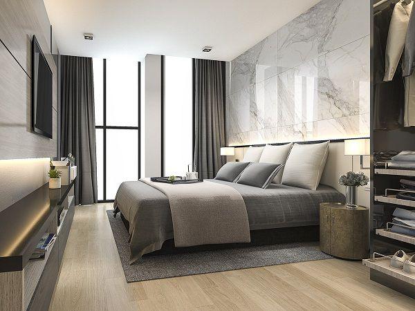 Gạch bóng kiếng màu trắng, vân đá đen tinh tế kết hợp cùng san gỗ sang trọng, ấn tượng cho phòng khách